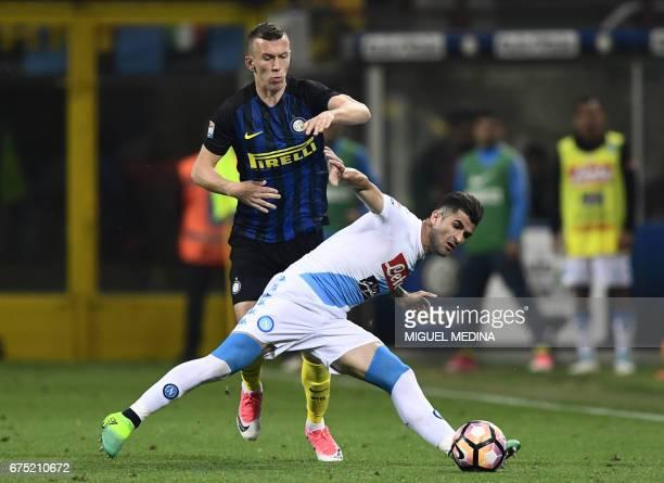 Napoli's Albanian defender Elseid Hysaj challenges Inter Milan's Croatian forward Ivan Perisic during the Italian Serie A football match between...