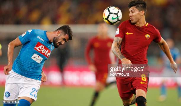 OLIMPICO ROME LAZIO ITALY Napoli's Albanian defender Elseid Hysaj heads the ball as fighting with Roma's Argentinian midfielder Diego Perotti during...