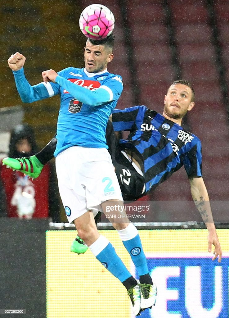 Napoli's Albanian defender Elseid Hysaj (L) heads the ball next to Atalanta's Slovenian midfielder Jasmin Kurtic during the Italian Serie A football match between SSC Napoli and Atalanta BC at San Paolo Stadium in Naples on May 2, 2016. / AFP / CARLO