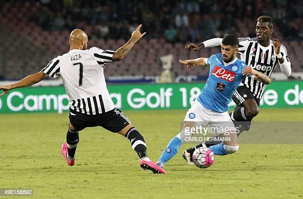 Napoli's Albanian defender Elseid Hysaj vies with Juventus' French midfielder Paul Pogba and Juventus' French forward Simone Zaza during the Italian...