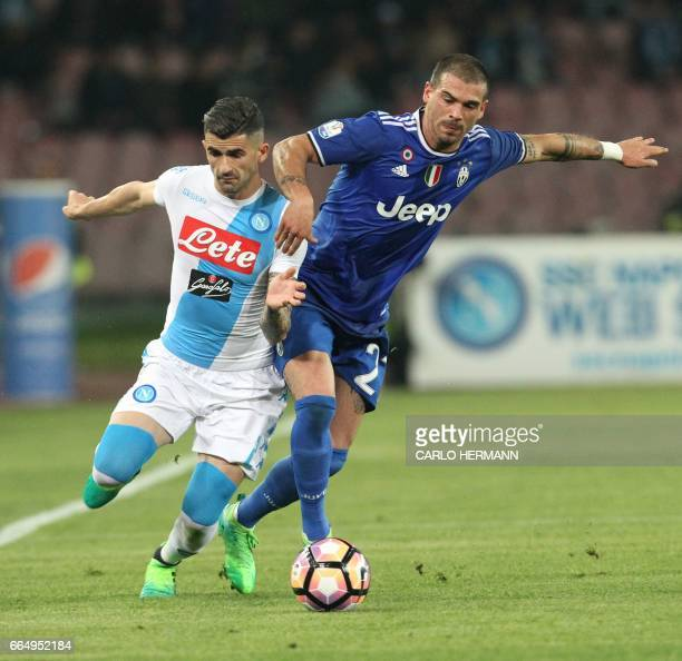 Napoli's Albanian defender Elseid Hysaj vies with Juventus' midfielder from Italy Stefano Sturaro during the Tim Cup semifinal second leg football...