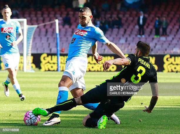 Napoli's Algerian defender Faouzi Ghoulam fights for the ball with Verona's Italian defender Eros Pisano during the Italian Serie A football match...