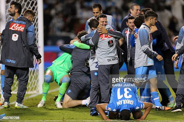 Napoli's Algerian defender Faouzi Ghoulam kneels on the ground to pray in celebration after winning the penalty shootout during the Italian Super Cup...