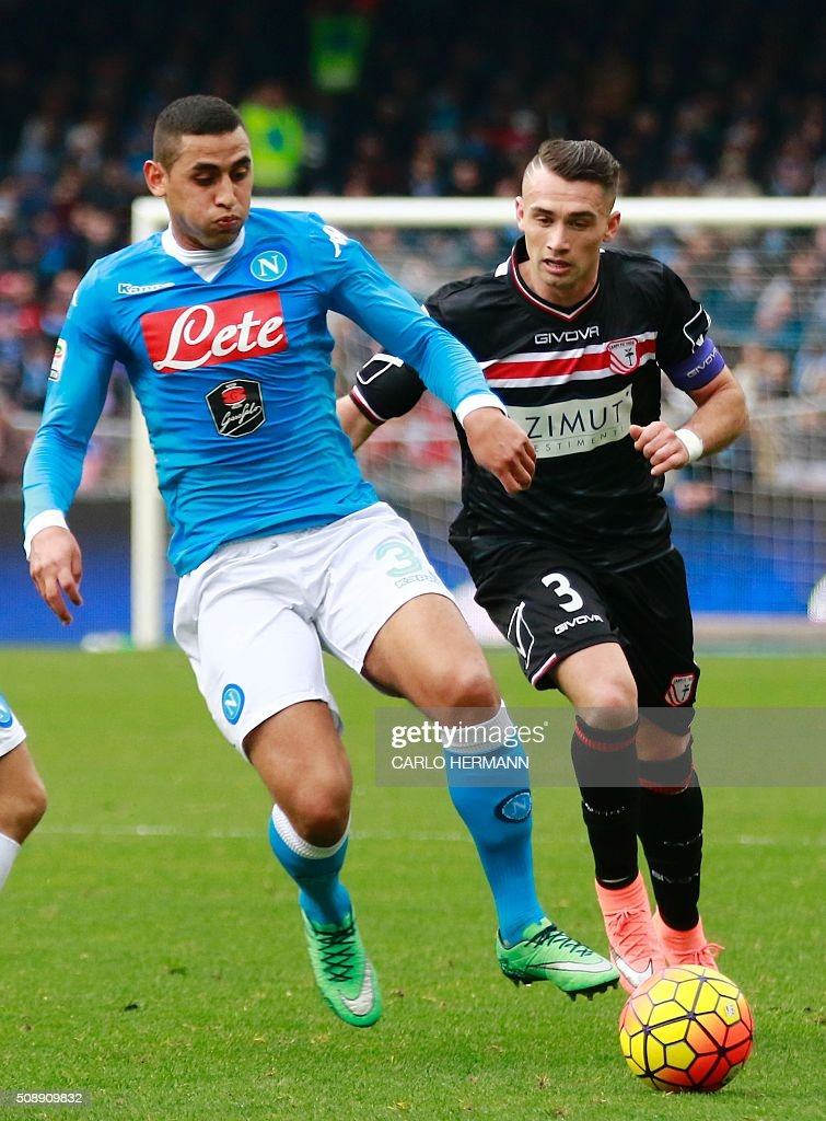 Napoli's Algerian defender Faouzi Ghoulam (L) vies with Carpi's Italian defender Gaetano Letizia during the Italian Serie A football match SSC Napoli vs Carpi FC on February 7, 2016 at the San Paolo stadium in Naples. / AFP / CARLO HERMANN