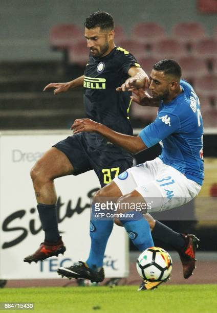 Napoli's Algerian defender Faouzi Ghoulam vies with Inter Milan's Italian midfielder Antonio Candreva during the Italian Serie A football match SSC...