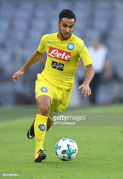 Napoli's Algerian midfielder Adam Ounas plays the ball during the first Audi Cup football match between Atletico Madrid and SSC Napoli in the stadium...