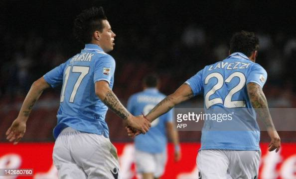 SSC Napoli's Argentinian forward Ezequiel Lavezzi celebrates after scoring with team mate Slovak forward Marek Hamsik during the Italian Serie A...