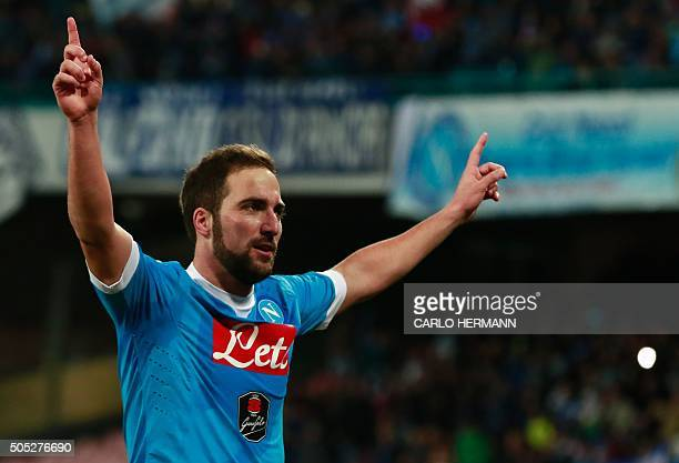 Napoli's Argentinian forward Gonzalo Higuain celebrates after scoring a goal during the Italian Serie A football match Napoli and Sassuolo Calcio at...