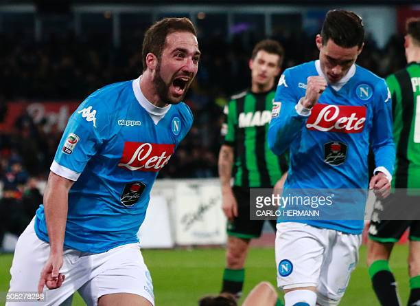 Napoli's Argentinian forward Gonzalo Higuain celebrates after scoring a goal during the Italian Serie A football match Napoli and Sassuolo Calcio at...