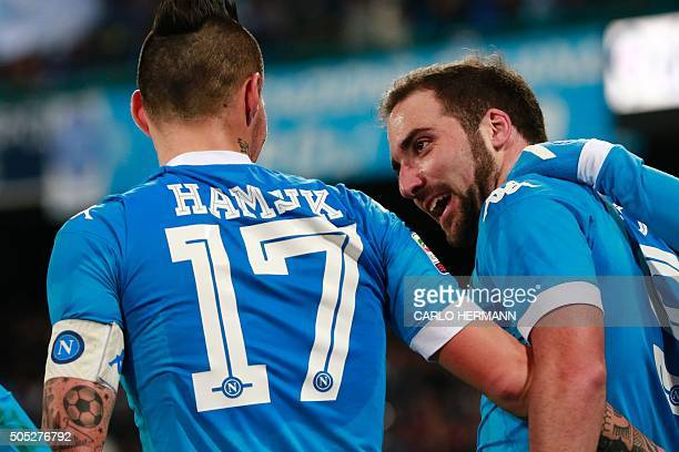 Napoli's Argentinian forward Gonzalo Higuain celebrates with Napoli's Slovak forward Marek Hamsik after scoring a goal during the Italian Serie A...