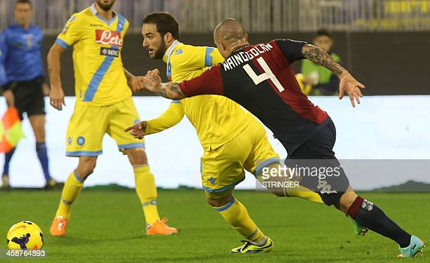 Napoli's Argentinian forward Gonzalo Higuain fights for the ball with Cagliari's Belgian midfielder Radja Nainggolan during the Italian Serie A...