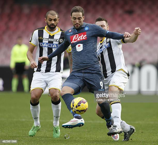 Napoli's Argentinian forward Gonzalo Higuain fights for the ball with Udinese's Brazilian midfielder Loureiro Marques Allan and Udinese's Italian...