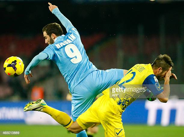 Napoli's Argentinian forward Gonzalo Higuain fights for the ball with Chievo Verona's Slovenian defender Bostjan Cesar during the Italian Serie A...