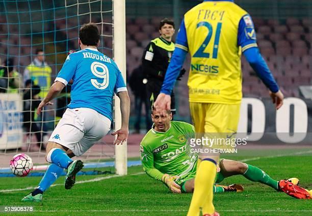Napoli's Argentinian forward Gonzalo Higuain scores a goal against Chievo's Argentinian goalkeeper Albano Bizzarri during the Italian Serie A...