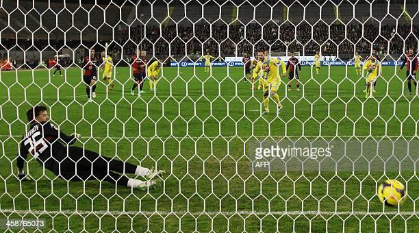 Napoli's Argentinian forward Gonzalo Higuain scores a penalty during the Italian Serie A football match Cagliari Calcio vs SSC Napoli in Sant'Elia...