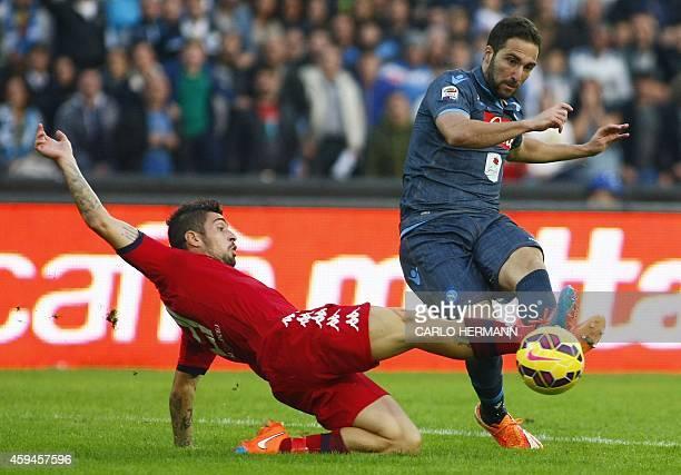 Napoli's Argentinian forward Gonzalo Higuain vies for the ball with Cagliari's Italian defender Antonio Balzano during the Italian Serie A football...
