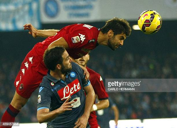 Napoli's Argentinian forward Gonzalo Higuain vies with Cagliari's Italian defender Luca Rossettini during the Italian Serie A football match SSC...