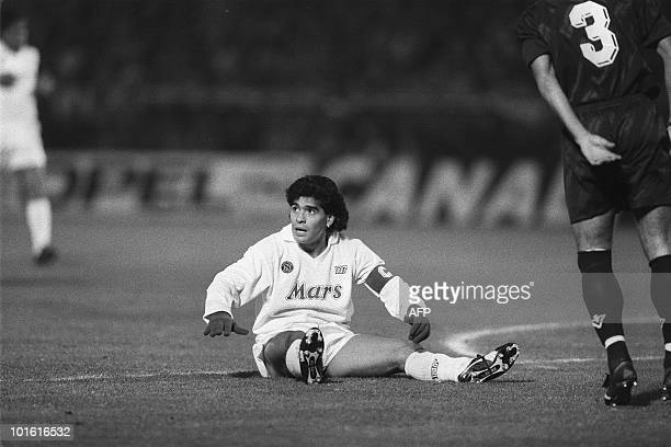 Napoli's Argentinian star player Diego Maradona recovers after a fall 23 November 1988 during the eighthfinal UEFA Cup match against Bordeaux AFP...