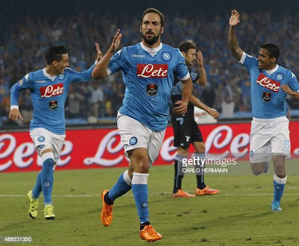 Napoli's ArgentinianFrench forward Gonzalo Higuain celebrates after scoring during the Italian Serie A football match SSC Napoli vs SS Lazio on...