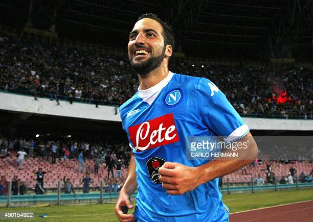 Napoli's ArgentinianFrench forward Gonzalo Higuain celebrates after scoring during the Italian Serie A football match SSC Napoli vs FC Juventus on...