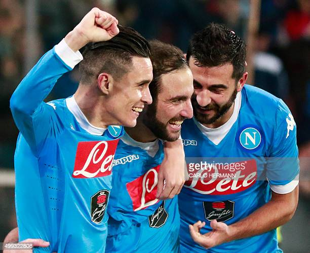 Napoli's ArgentinianFrench forward Gonzalo Higuain celebrates after scoring with teammates Napoli's Spanish forward Jose Maria Callejon and Napoli's...