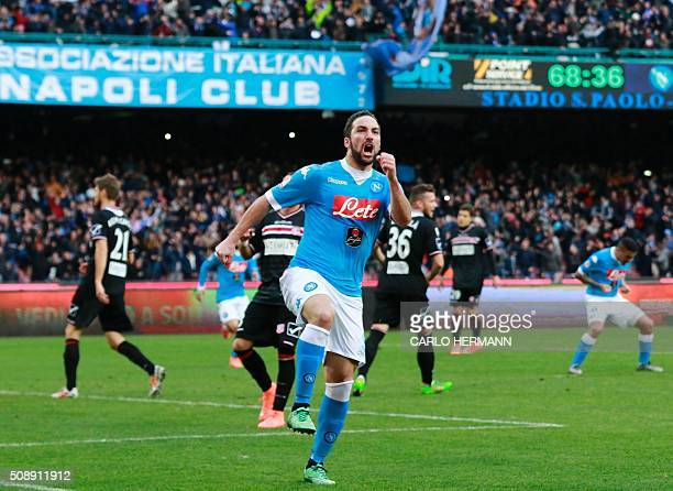 Napoli's ArgentinianFrench forward Gonzalo Higuain celebrates after scoring during the Italian Serie A football match SSC Napoli vs Carpi FC on...