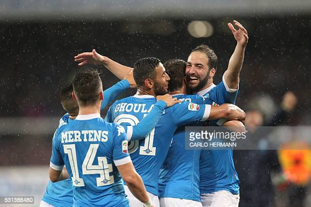 TOPSHOT Napoli's ArgentinianFrench forward Gonzalo Higuain celebrates after scoring his 36th goal in the season during the Italian Serie A football...