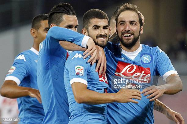 Napoli's ArgentinianFrench forward Gonzalo Higuain celebrates with teammates after scoring during the Italian Serie A football match SSC Napoli vs SS...
