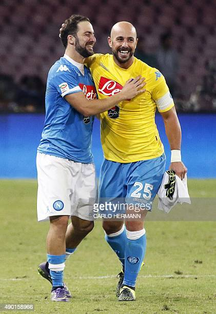Napoli's ArgentinianFrench forward Gonzalo Higuain celebrates with Napoli's Spanish goalkeeper Pepe Reina at the and of the Italian Serie A football...
