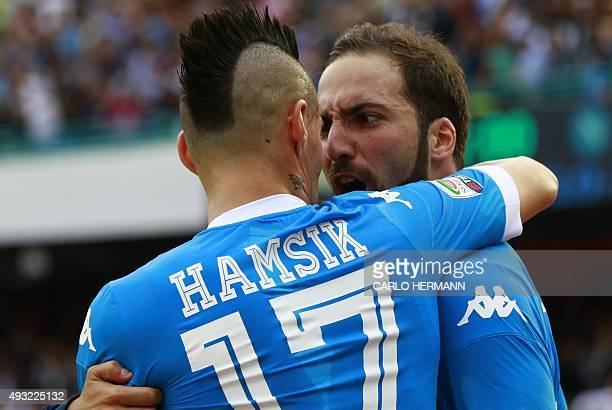 Napoli's ArgentinianFrench forward Gonzalo Higuain celebrates with teammate Napoli's Slovak forward Marek Hamsik after scoring during the Italian...