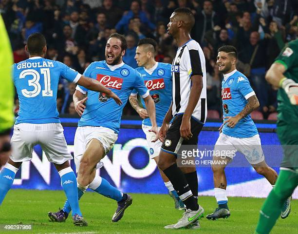 Napoli's ArgentinianFrench forward Gonzalo Higuain celebrates with teammates after scoring during the Italian Serie A football match SSC Napoli vs...