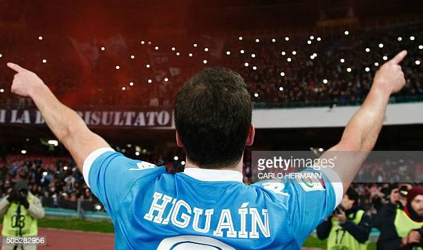 Napoli's ArgentinianFrench forward Gonzalo Higuain celebrates with fans after winning the Italian Serie A football match between Napoli and Sassuolo...