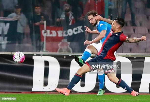Napoli's ArgentinianFrench forward Gonzalo Higuain fights for the ball with Genoa's Italian defender Armando Izzo during the Italian Serie A football...