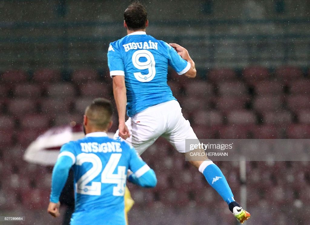 Napoli's Argentinian-French forward Gonzalo Higuain jumps up as he celebrate after scoring during the Italian Serie A football match between SSC Napoli and Atalanta BC at San Paolo Stadium in Naples on May 2, 2016. / AFP / CARLO