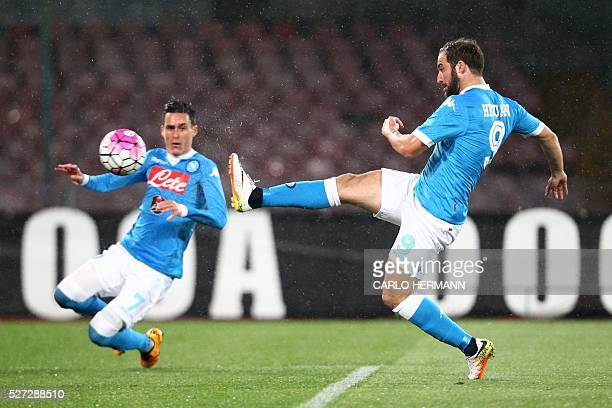 Napoli's ArgentinianFrench forward Gonzalo Higuain kicks to score near his teammate Napoli's Spanish forward Jose Maria Callejon during the Italian...