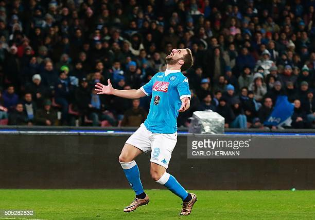 Napoli's ArgentinianFrench forward Gonzalo Higuain reacts after missing a goal opportunity during the Italian Serie A football match between Napoli...
