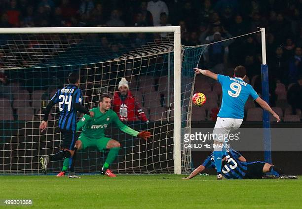Napoli's ArgentinianFrench forward Gonzalo Higuain scores during the Italian Serie A football match SSC Napoli vs Inter Milan on November 30 2015 at...
