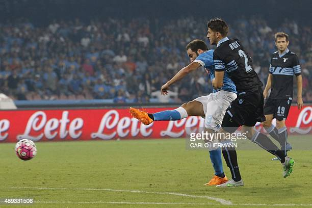 Napoli's ArgentinianFrench forward Gonzalo Higuain scores past Lazio's Dutch defender Wesley Hoedt during the Italian Serie A football match SSC...