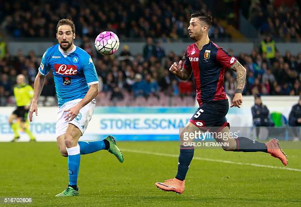 Napoli's ArgentinianFrench forward Gonzalo Higuain vies with Genoa's Italian defender Armando Izzo during the Italian Serie A football match SSC...