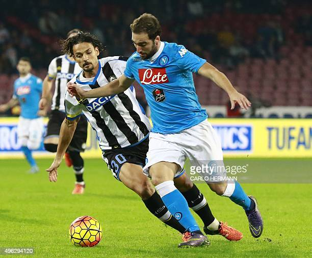 Napoli's ArgentinianFrench forward Gonzalo Higuain vies with Udinese's Brazilian defender Felipe Dal Bello during the Italian Serie A football match...