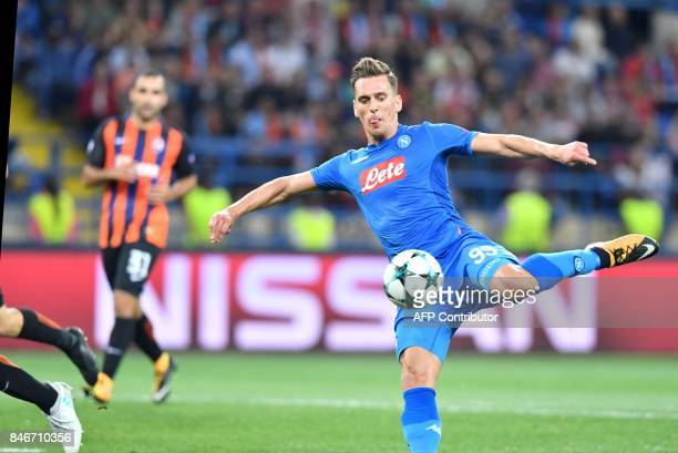 Napoli's Arkadiusz Milik prepares to strike during the UEFA Champions League Group F football match FC Shakhtar Donetsk and SSC Napoli at the...