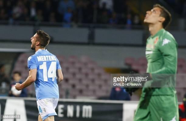 Napoli's Belgian forward Dries Mertens celebrates after scoring a goal as Cagliari's Italian goalkeeper Marco Silvestri reacts during the Italian...