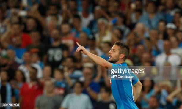 Napoli's Belgian forward Dries Mertens celebrates after scoring during the UEFA Champions League Play Off first leg football match SSC Napoli vs OCG...