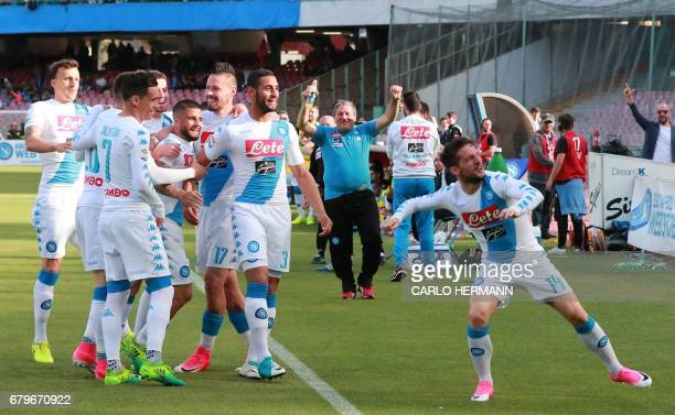 Napoli's Belgian forward Dries Mertens celebrates after scoring with teammates during the Italian Serie A football match SSC Napoli vs Cagliari...