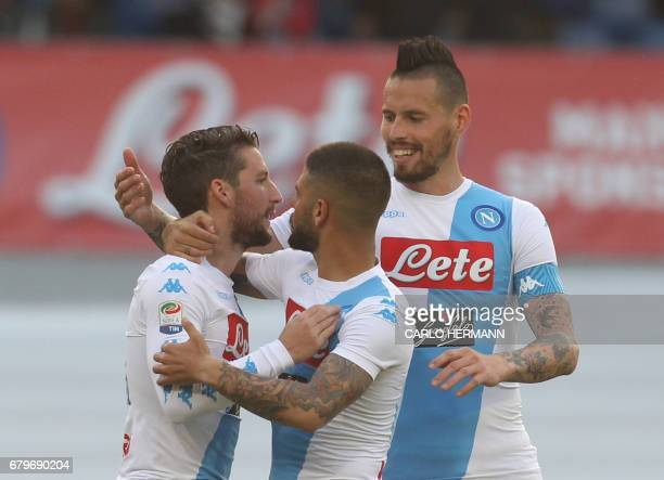 Napoli's Belgian forward Dries Mertens celebrates after scoring with teammates Napoli's Italian forward Lorenzo Insigne and Napoli's Slovakian...