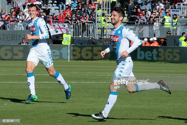 Napoli's Belgian forward Dries Mertens celebrates with Napoli's Romanian defender Vlad Chiriches after scoring a goal during the Italian Serie A...