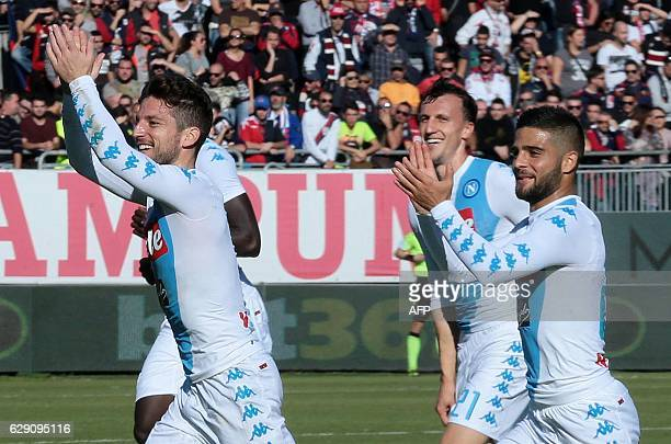 Napoli's Belgian forward Dries Mertens celebrates with Napoli's Romanian defender Vlad Chiriches and Napoli's Italian forward Lorenzo Insigne after...