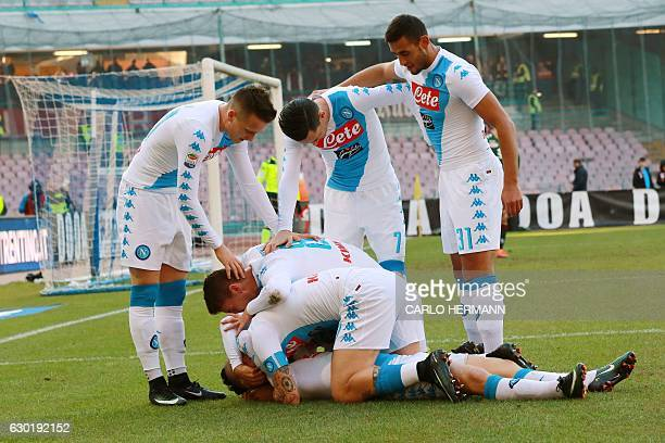 Napoli's Belgian forward Dries Mertens celebrates with team mates after scoring a goal during an Italian Serie A football match between SSC Napoli...