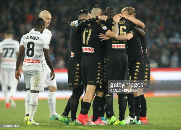 Napoli's Belgian forward Dries Mertens celebrates with teammates after scoring during the Italian Serie A football match SSC Napoli vs Udinese Calcio...