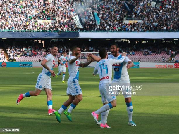 Napoli's Belgian forward Dries Mertens celebrates with teammates after scoring during the Italian Serie A football match SSC Napoli vs Cagliari...